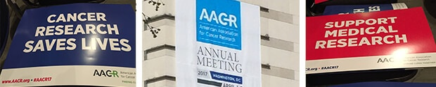 Cancer research signs at AACR